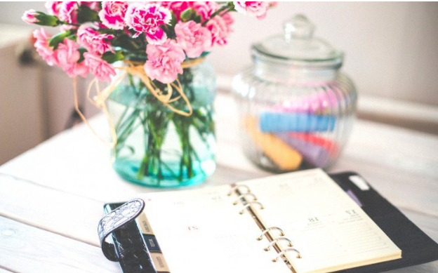 flowers and planner on desk